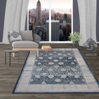 Milani Oriental Border Blue Area Rug Rug Size: Rectangle 77 x 10
