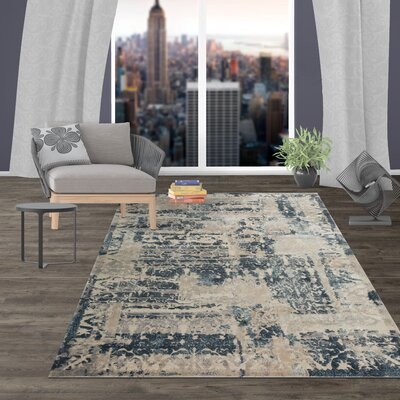 Zeke Distressed Vintage Blue/Ivory Area Rug Rug Size: Rectangle 5 x 7