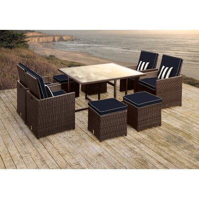 Stella II Patio Rattan 9 Piece Dining Set with Cushions and Square Toss Pillows Cushion Color: Navy/Cream