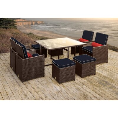 Stella II Patio Rattan 9 Piece Dining Set with Cushions and Cylinder Toss Pillows Cushion Color: Navy/Cream