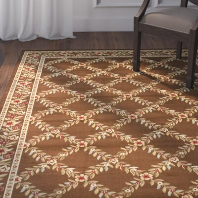 Taufner Brown Checked Area Rug Rug Size: 53 x 76