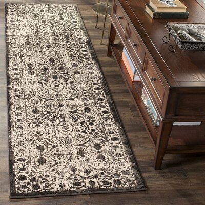 Roma Brown / Black Area Rug Rug Size: Rectangle 51 x 76