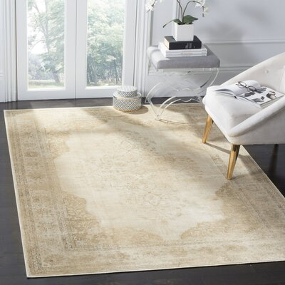 Cream Area Rug Rug Size: 67 x 92