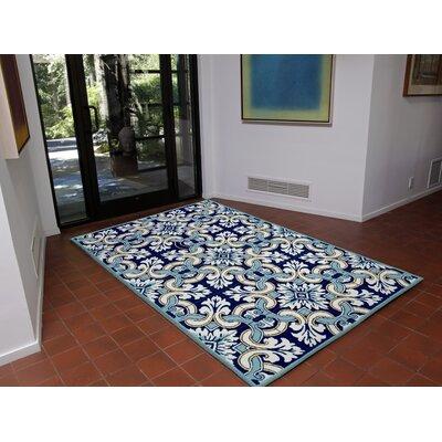 Demirhan Floral Tile Blue Area Rug Rug Size: 83 x 116