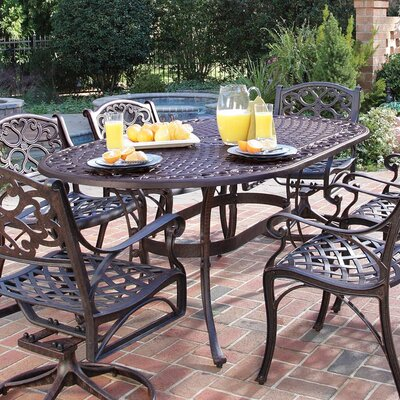 Van Glider Oval Outdoor Dining Table Finish: Antique Deep Rust Brown