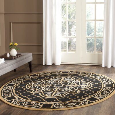 Gresham Palace Hand-Hooked Black/Gold Area Rug Rug Size: Rectangle 6 x 9