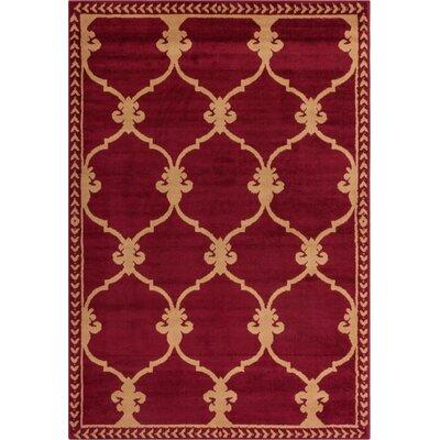 Coggrey Fleur De Lis Red Area Rug Rug Size: 82 x 910