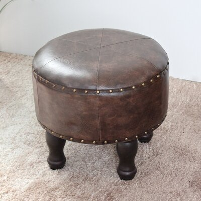 Stone Castle Round Ottoman Upholstery: Brown