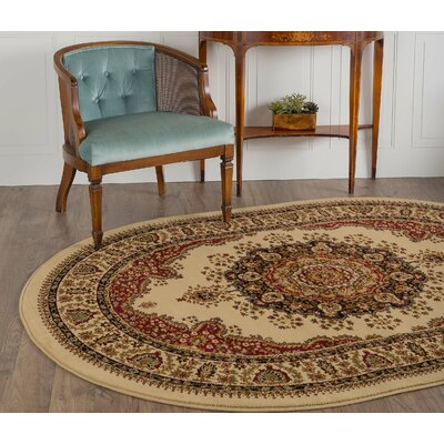 Clarence Ivory/Red Area Rug Rug Size: Oval 67 x 96