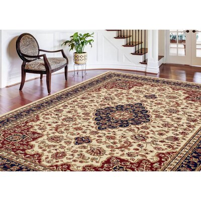 Clarence Ivory/Red/Navy Blue Area Rug