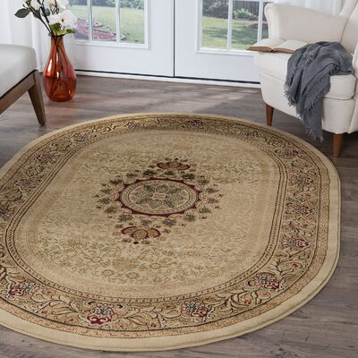 Clarence Beige Area Rug Rug Size: Oval 67 x 96
