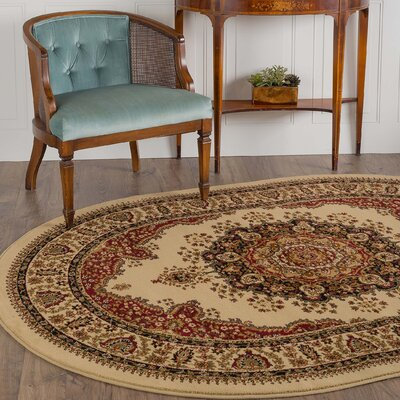 Clarence Ivory/Red Area Rug Rug Size: Oval 53 x 73