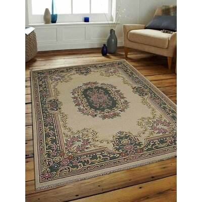Shephard Hand-Woven Wool Ivory/Green Area Rug Rug Size: Rectangle 67 x 910