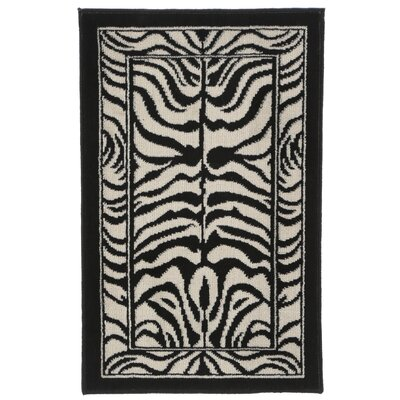Kaly Zebra Print Ebony Area Rug Rug Size: 110 x 211