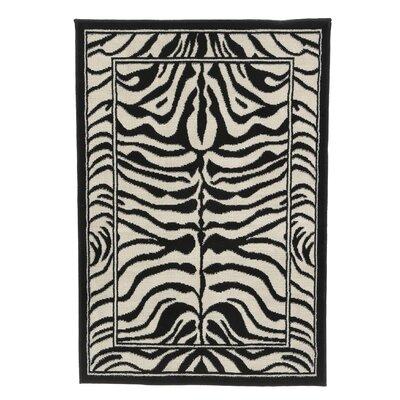 Kaly Zebra Print Ebony Area Rug Rug Size: 79 x 108