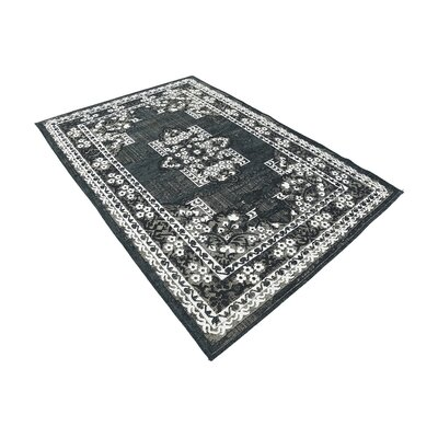Jan Black Area Rug Rug Size: 49 x 67