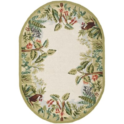 Bridges Green/Ivory Novelty Area Rug Rug Size: Oval 76 x 96