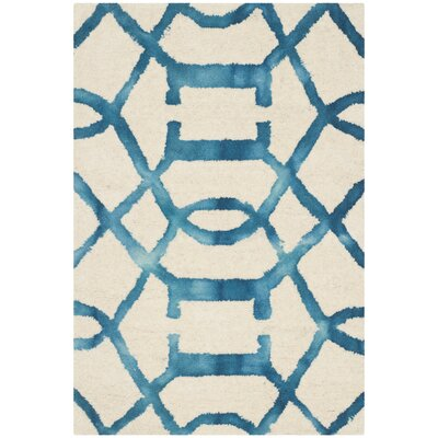 Braylee Ivory/Turquoise Area Rug Rug Size: Rectangle 5 x 8