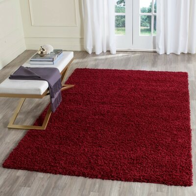 Caine Red Area Rug Rug Size: 9 x 12