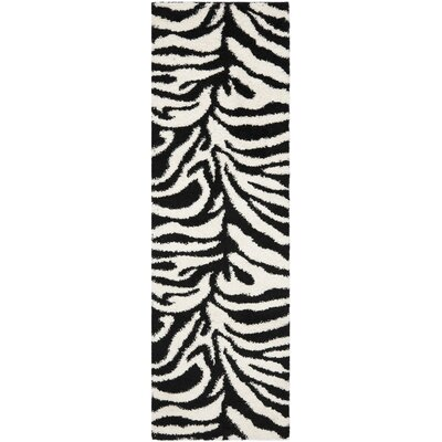 Davey Ivory/Black Outdoor Area Rug Rug Size: Runner 23 x 7