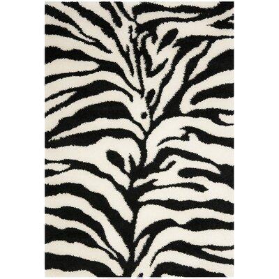 Davey Ivory/Black Area Rug Rug Size: 53 x 76