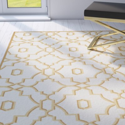 Marjorie Ivory/Tan Indoor/Outdoor Area Rug Rug Size: 36 x 56