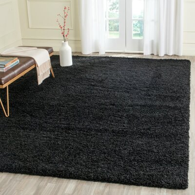 Beldon Power Loom Black Area Rug Rug Size: Rectangle 67 x 96