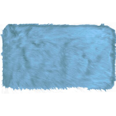 Chantay Faux Fur Blue Area Rug