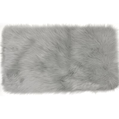 Chantay Faux Fur Gray Area Rug