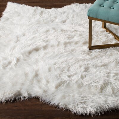 Libby Faux Sheep Skin Ivory Area Rug Rug Size: 9 x 12