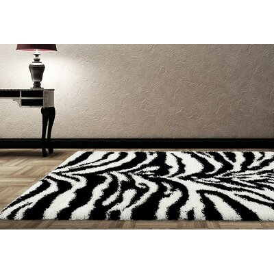 Creissant White/Black Indoor/Outdoor Area Rug Rug Size: 7 x 10