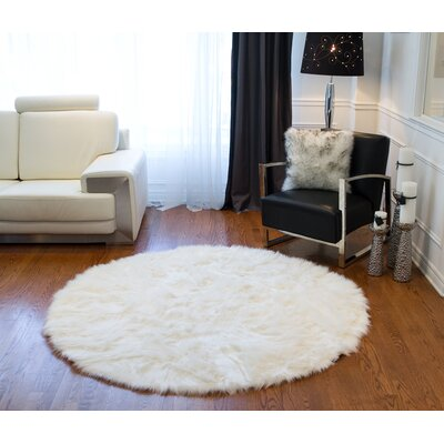 Rossman Off White Faux Fur Area Rug