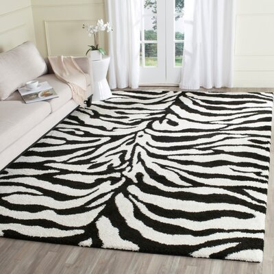 Davey Ivory/Black Outdoor Area Rug Rug Size: Rectangle 53 x 76
