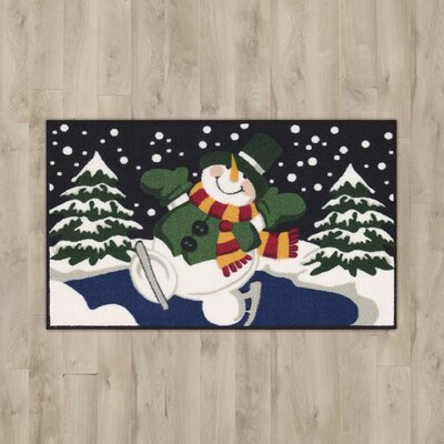 Snowman Skating Black/Green Area Rug Rug Size: 15 x 24