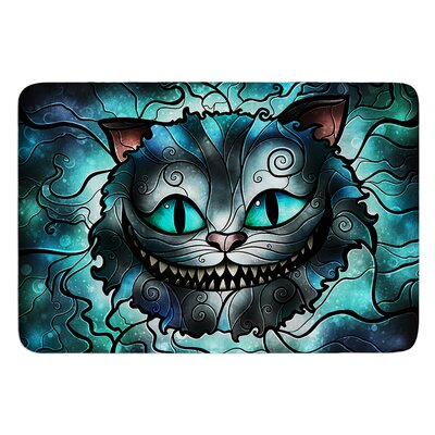 Mad Chesire by Mandie Manzano Bath Mat