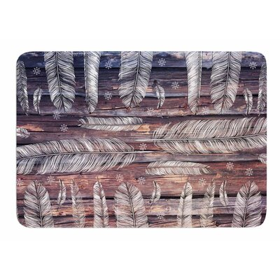 Snowflakes And Feathers by Suzanne Carter Bath Mat
