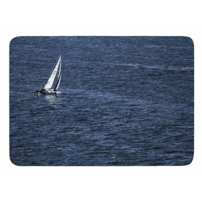 Boat On The Ocean by Nick Nareshni Bath Mat