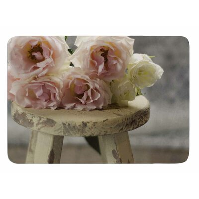 Roses on Stool by Cristina Mitchell Bath Mat