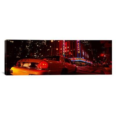 'Car on a Road, Radio City Music Hall, Rockefeller Centre, Manhattan' Photographic Print on Canvas EASU3620 34069264