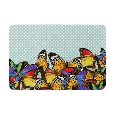 Butterfly by Suzanne Carter Bath Mat Color: Teal