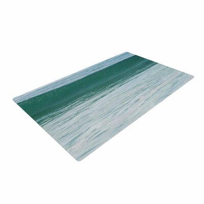 Nick Nareshni The Lone Wave Teal/Blue Area Rug