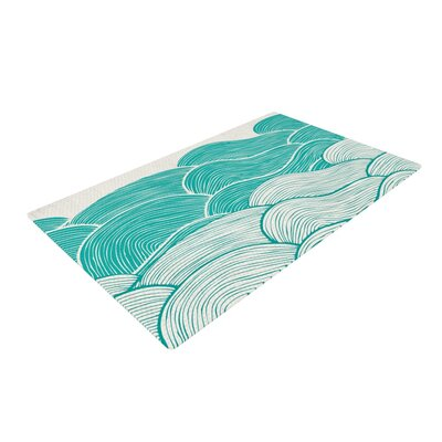 Pom Graphic Design the Calm and Stormy Seas Green/Teal Area Rug