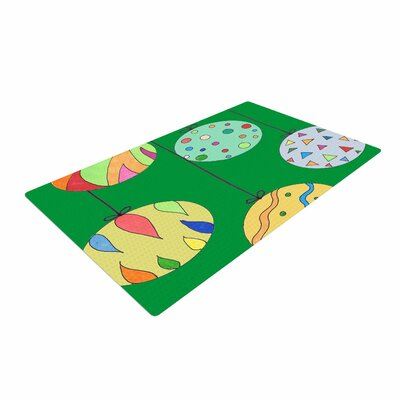 Rosie Brown Trim the Tree Green Multicolor Area Rug