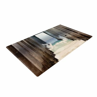 Sylvia Coomes Under the Pier Blue/Brown Area Rug