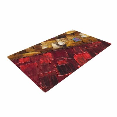 Steven Dix Movement Beneath Red/Brown Area Rug