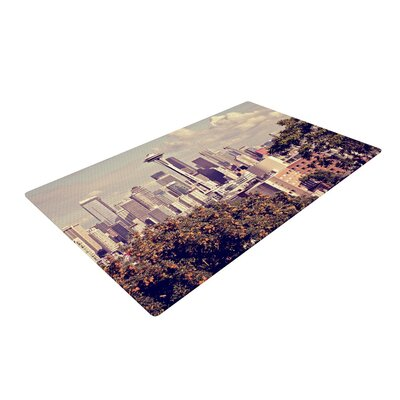 Sylvia Cook Space Needle Skyline Beige Area Rug