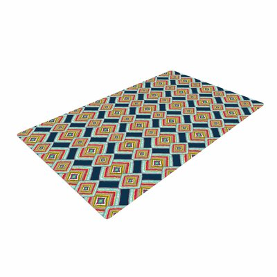 Amy Reber Rainbow IKAT Abstract Green Area Rug