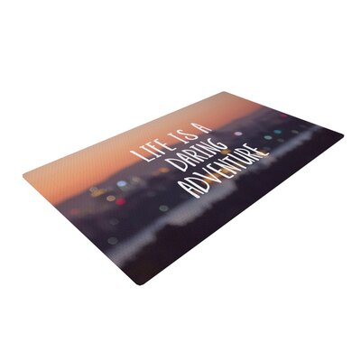 Jillian Audrey Life Is A Daring Adventure Typography Black/Orange Area Rug