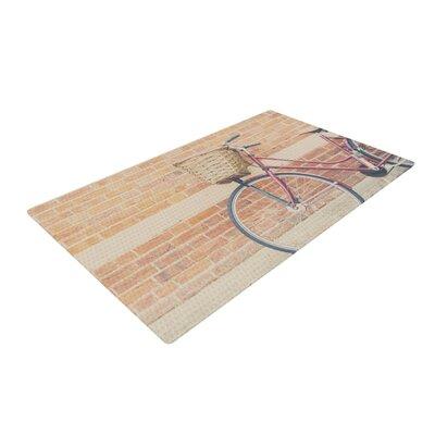 Laura Evans A Bicycle Orange/Brown/Red Area Rug