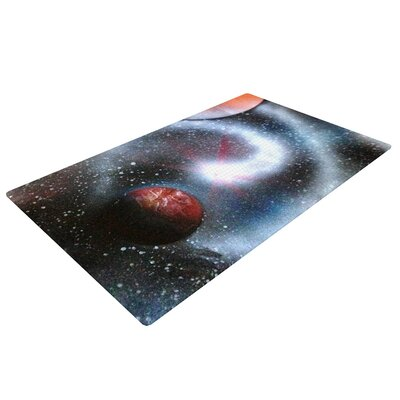 Infinite Spray Art Starburst Galaxy Black/Red Area Rug Rug Size: 2 x 3